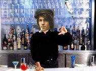 Young Mike, crafting cocktails, flipping bottles.